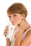 Woman with bottle of body lotion Stock Photography