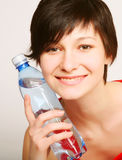 Woman with bottle of clean water Stock Images