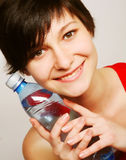 woman with bottle of clean water Royalty Free Stock Image