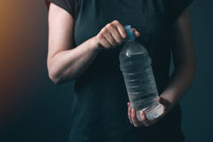 Woman with bottle of fresh drinking water Stock Photography
