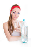 Woman with bottle and glass of water Royalty Free Stock Photo