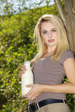 Woman with a bottle of milk Stock Photos