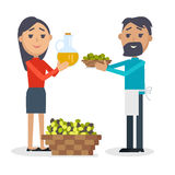 Woman with Bottle of Olive Oil, Man with Olives Royalty Free Stock Image
