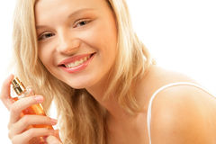 Woman with bottle of perfume Stock Photos