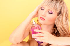 Woman with bottle of perfume Stock Photography