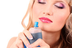 Woman with bottle of perfume Royalty Free Stock Photos