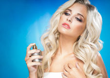 Woman with a bottle of perfume Stock Image