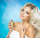 Woman with a bottle of perfume Royalty Free Stock Photos