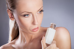 Woman with bottle of perfume. Stock Image