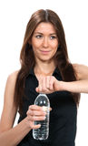 Woman with bottle of pure still drinking water holding in hand  Stock Photography