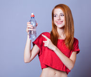 Woman with bottle. Royalty Free Stock Photography