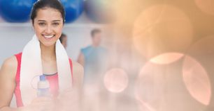 Woman with bottle and towel and peach bokeh transition Stock Images
