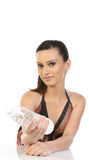 Woman with bottle of water. Young woman with bottle of water indoors Royalty Free Stock Image