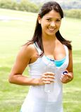 Woman with a bottle of water Royalty Free Stock Photography