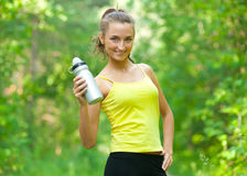 Woman with bottle of water Royalty Free Stock Images