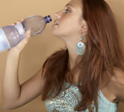 Woman with bottle of water. Young beautiful woman with bottle of water Royalty Free Stock Photos