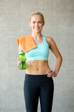 Woman with bottle of water in gym Stock Images