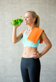Woman with bottle of water in gym Stock Photo