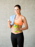 Woman with bottle of water in gym Stock Photos