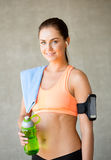 Woman with bottle of water in gym Stock Image
