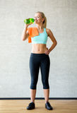 Woman with bottle of water in gym Royalty Free Stock Image