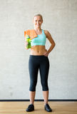Woman with bottle of water in gym Stock Photography