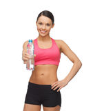Woman with bottle of water Royalty Free Stock Photography