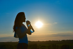 Woman with bottle of water Royalty Free Stock Photos