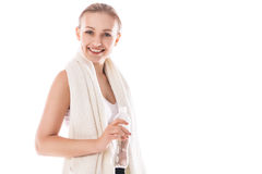 Woman with bottle of water and towel. Fitness wear Stock Images