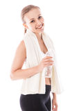 Woman with bottle of water and towel. Fitness wear Royalty Free Stock Photo