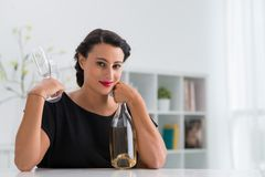 Woman with a bottle of wine Stock Images