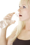 Woman with bottled water Royalty Free Stock Image