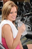 Woman With Bottled Water at the Gym Royalty Free Stock Photography