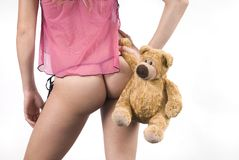 Woman bottom with bear toy Stock Image