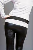 Woman bottom wearing black leather pants stock photo