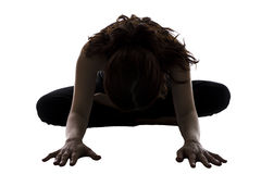 Woman in Bound Angle Pose or Baddha Konasana. Woman is doing Bound Angle Pose in Yoga silhouette Stock Photo