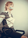 Woman bound by contract terms with taped mouth. Royalty Free Stock Photos