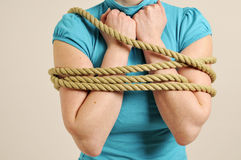 Woman bound with rope. Body of young woman bound with rope, studio background royalty free stock photography