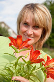 Woman with a bouquet Stock Photos