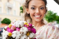 Woman with bouquet Stock Images