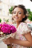 Woman with bouquet Royalty Free Stock Photos