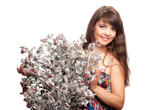 Woman with a bouquet of artificial flowers Royalty Free Stock Photography