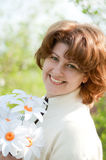 Woman with  bouquet of daisies Royalty Free Stock Photos