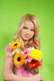 Woman with a bouquet of flowers Royalty Free Stock Photography