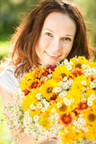 Woman with bouquet of flowers Stock Image