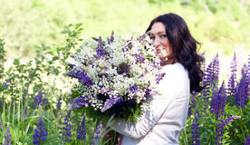 Woman with a bouquet of flowers Stock Images