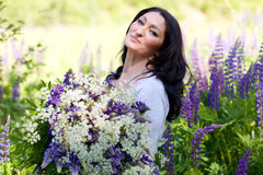 Woman with a bouquet of flowers Stock Image