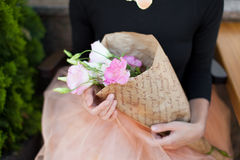 Woman with a bouquet of flowers beautiful hand skirt tutu give f Royalty Free Stock Images