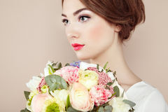 Woman with bouquet of flowers in her hands royalty free stock photography