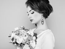 Woman with bouquet of flowers in her hands Royalty Free Stock Photo
